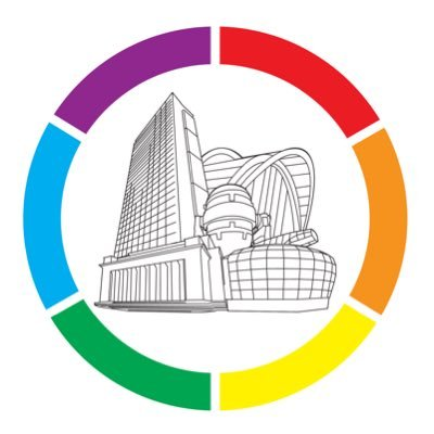 The logo of LGBT+ Sheffield, a circular border of rainbow colours with Sheffield buildings in the middle